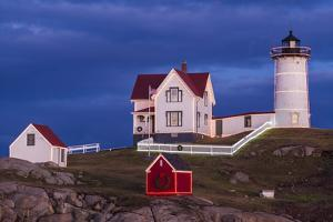 USA, Maine, York Beach, Nubble Light Lighthouse with Christmas decorations at dusk by Walter Bibikow
