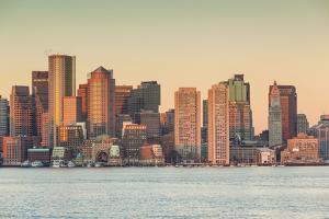USA, Massachusetts, Boston. City skyline from Boston Harbor at dawn. by Walter Bibikow
