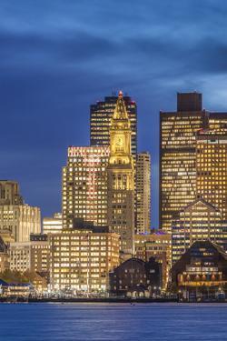 USA, Massachusetts, Boston. City skyline from Boston Harbor at dusk. by Walter Bibikow