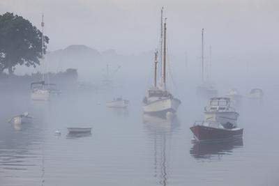 USA, Massachusetts, Cape Ann, boats in Annisquam Harbor in fog by Walter Bibikow