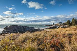 USA, Massachusetts, Cape Ann, Gloucester. Annisquam Lighthouse during autumn. by Walter Bibikow