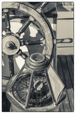 USA, Massachusetts, Cape Ann, Gloucester, schooner marine compass and ship's wheel by Walter Bibikow