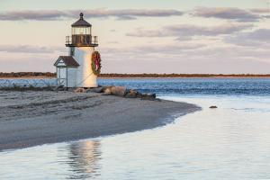 USA, Massachusetts, Nantucket Island, Brant Point Lighthouse with a Christmas wreath at dusk. by Walter Bibikow