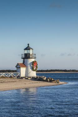 USA, Massachusetts, Nantucket Island, Brant Point Lighthouse with a Christmas wreath. by Walter Bibikow
