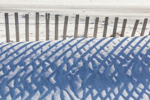 USA, Massachusetts, Nantucket Island. Madaket. Madaket Beach, sand fence and shadows. by Walter Bibikow