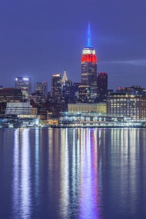 USA, New York City, Manhattan skyline with Empire State Building from Hoboken by Walter Bibikow