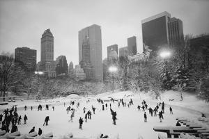 USA, New York, New York City, Skaters at the Wollman Rink by Walter Bibikow