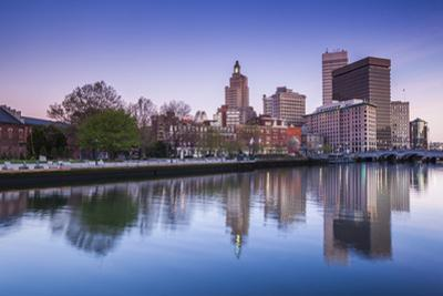 USA, Rhode Island, Providence, city skyline from the Providence River at dawn by Walter Bibikow