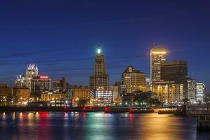 USA, Rhode Island, Providence, city skyline from the Providence River at dusk by Walter Bibikow