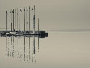 Veneto, Lake District, Lake Garda, Garda, Lakeside Pier and Lighthouse, Italy by Walter Bibikow