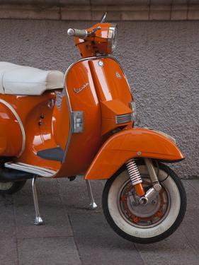 Vespa Scooter, Llanes, Spain by Walter Bibikow
