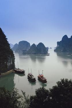 Vietnam, Halong Bay, Tourist Boats Anchor at the Cave of Marvels by Walter Bibikow