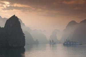 Vietnam, Halong Bay, Tourist Boats, Sunrise by Walter Bibikow