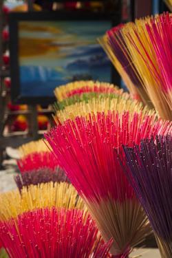 Vietnam, Hue. Arrangement of Incense Sticks by Walter Bibikow