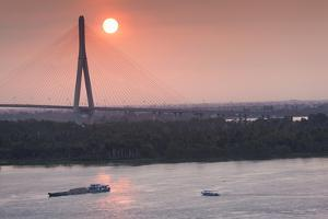 Vietnam, Mekong Delta. Can Tho, Can Tho Bridge, Elevated View, Sunrise by Walter Bibikow