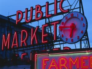 View of Public Market Neon Sign and Pike Place Market, Seattle, Washington, USA by Walter Bibikow