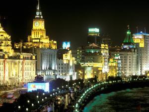 View of the Bund Area Illuminated at Night, Shanghai, China by Walter Bibikow