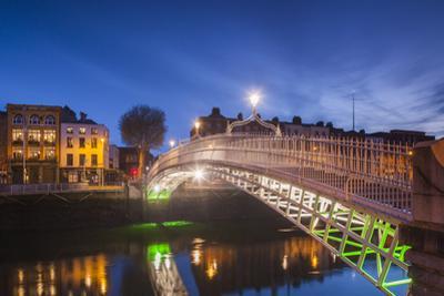 Ireland, Dublin, Hapenny Bridge over the River Liffey, dawn by Walter Bibikw