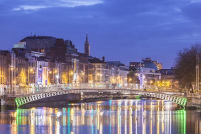 Ireland, Dublin, Hapenny Bridge over the River Liffey, dusk by Walter Bibikw