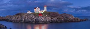 USA, Maine, York Beach, Nubble Light Lighthouse with Christmas decorations, dusk by Walter Bibikw