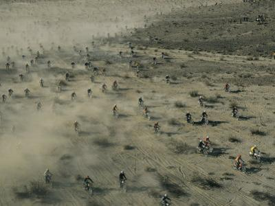 Aerial View of Hundreds of Motorcyclists Racing Across the Mojave Desert