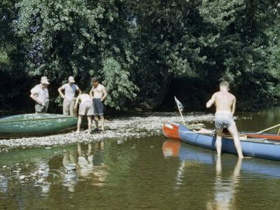 Men Stop to Repair Canoes Along Rocky Shallows of Susquehanna River