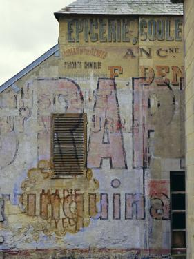 Fading Painted Writing on Back Street Wall, Bayeux, Basse Normandie (Normandy), France, Europe by Walter Rawlings