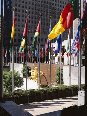 Flags Outside the Rockefeller Center, New York City, New York, USA by Walter Rawlings