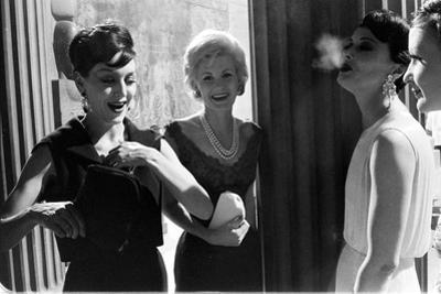 A Group of Women Laughing Together at the Met Fashion Ball, New York, November 1960 by Walter Sanders