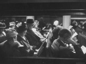 Commuters Reading on the Train by Walter Sanders
