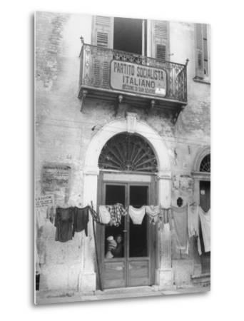 Laundry Hanging in Front of Local Headquarters by Walter Sanders