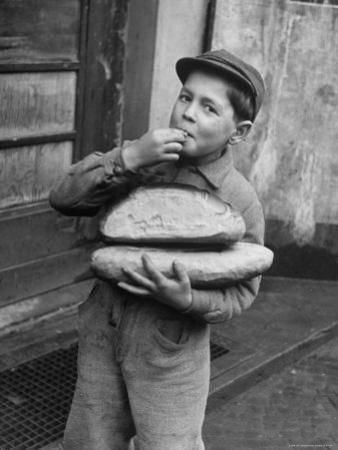 Little Boy Holding Loaves of Bread by Walter Sanders