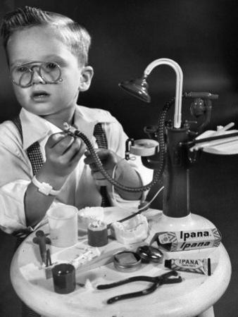 Little Boy with a Toy Dentist Set by Walter Sanders