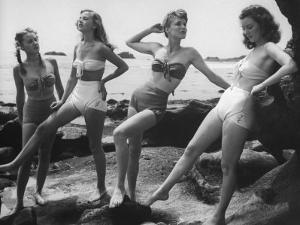 "Models Wearing ""California"" Bathing Suits, with No Shoulder Straps and Minimum Diaper Style Pants by Walter Sanders"