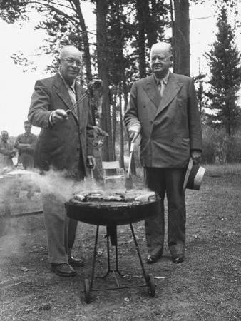 President Dwight D. Eisenhower Cooking Steaks with Former President Herbert C. Hoover by Walter Sanders