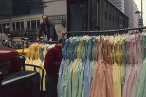 Push Boys Steer Racks of Dresses across Road in the Garment District, New York, New York, 1960 by Walter Sanders