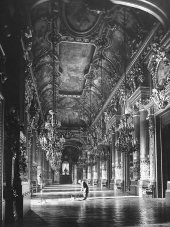 Worker Mopping the Floor of the Grand Foyer at the Opera House by Walter Sanders