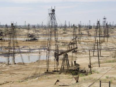Closely Spaced Drilling Towers and Nodding Donkey Beam Pumps, Ramana Oilfield, Baku, Azerbaijan