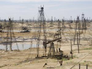 Closely Spaced Drilling Towers and Nodding Donkey Beam Pumps, Ramana Oilfield, Baku, Azerbaijan by Waltham Tony