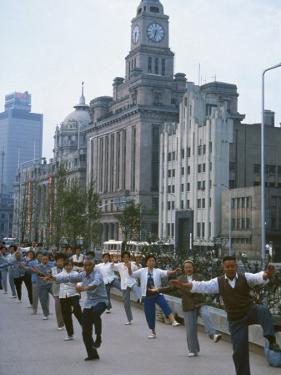 Early Morning Tai Chi in Front of Old Customs House, Shanghai, China by Waltham Tony