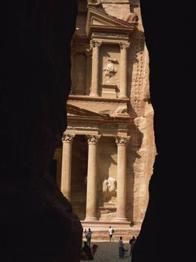 First View of Petra at the End of the Siq Entrance Gorge, Petra, Jordan, Middle East by Waltham Tony
