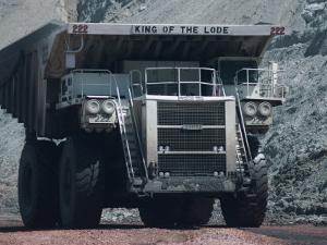 Giant Truck Hauling Coal in the Black Thunder Opencast Coal Mine, Powder River Basin, Wyoming, USA by Waltham Tony