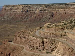 Mokee Dugway Road Descends from Cedar Mesa, in the Valley of the Gods, Utah, USA by Waltham Tony