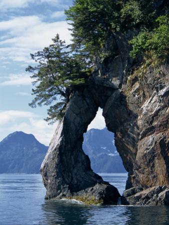 Natural Arch on Edge of Threehole Bay, Kenai Fjords, Aialik Peninsula, Alaska, USA