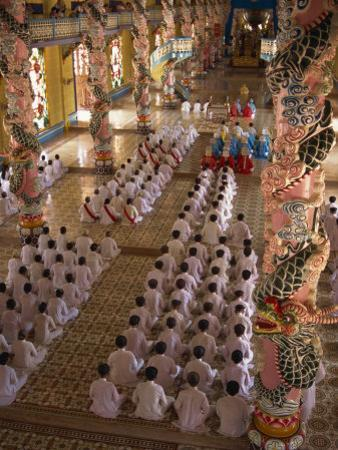 Rows of Monks at Prayer Inside a Temple of the Caodai Religious Sect, at Tay Ninh, Vietnam
