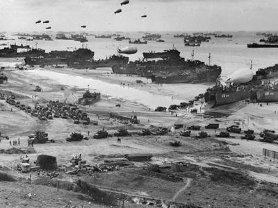 https://imgc.allpostersimages.com/img/posters/war-supply-point-scene-near-beach_u-L-PZODG60.jpg?artPerspective=n