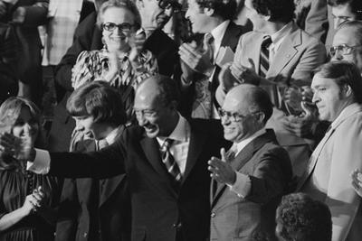 Anwar Sadat and Menachem Begin acknowledge President Carter as he announces the Camp David Accords by Warren K. Leffler