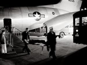 Wounded Servicemen Arriving from Vietnam at Andrews Air Force Base, 1968 by Warren K. Leffler