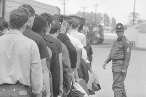 Young men who have been drafted wait in line to be processed into the US Army at Fort Jackson, SC by Warren K. Leffler