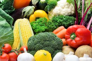 Close up of Fresh Raw Organic Vegetable Produce, Assortment of Corn, Peppers, Broccoli, Mushrooms, by warrengoldswain